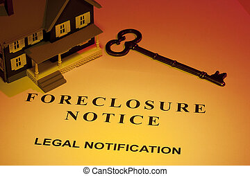 Foreclosure Notice - A key laying next to a house model and...