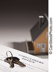 Foreclosure Notice, House Keys and Model Home on Gradated Background with Selective Focus.
