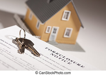 Foreclosure Notice, House Keys and Model Home on Gradated...