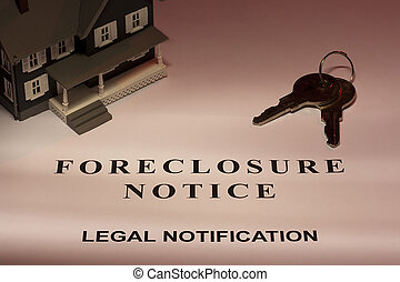 Foreclosure Notice - Set of house keys laying next to a...