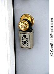 foreclosure - lockbox on home entrance