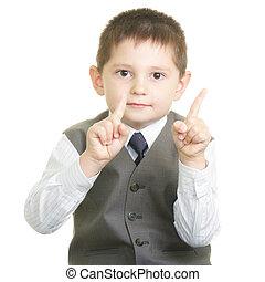 Forefingers raised in negation gesture - Little cute boy ...