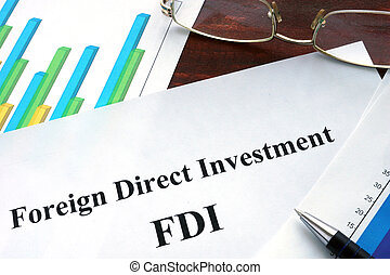 Foreign direct investment FDI form on a table. Business...