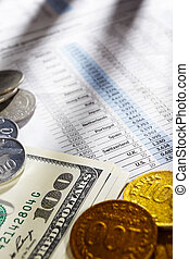 Foreign exchange sheep paper with dollar bills and coins from different countries on edge