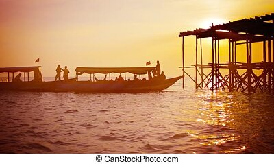 Foreign Tourists Visit Local Harbor at Sunset in Cambodia -...