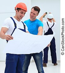 foreman and architect discussing construction project -...