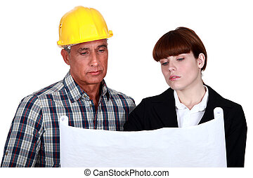 Foreman giving his opinion to architect
