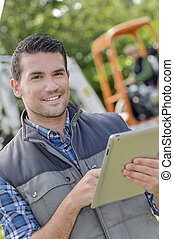 Foreman holding a tablet computer