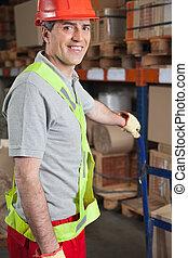Foreman Holding Handtruck At Warehouse
