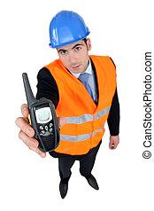 Foreman holding radio receiver