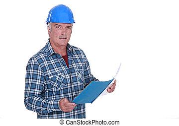 Foreman looking through paperwork