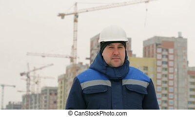 Foreman on background of major construction project