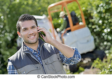 Foreman on the phone to a client