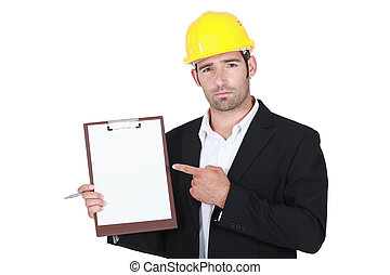 foreman pointing at clipboard