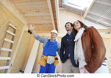 foreman shows new house to a young couple