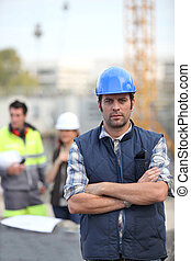 Foreman stood in front of two colleagues