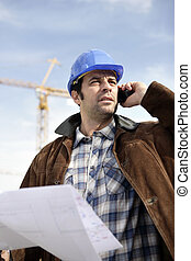 Foreman using a mobile telephone
