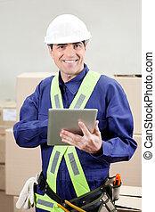 Foreman Using Digital Tablet At Warehouse