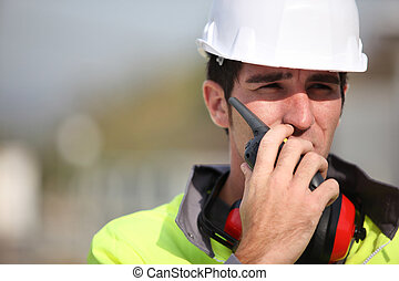 Foreman using radio to give instructions