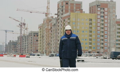 Foreman with brief case at major construction project