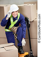 Foreman With Fork Pallet Truck At Warehouse