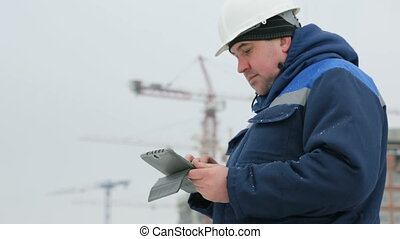 Foreman with pad at major construction project