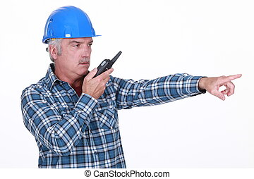 Foreman with radio pointing