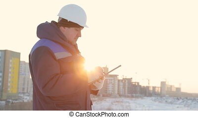 Foreman with tablet at major construction project