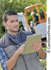 Foremen using a tablet on site