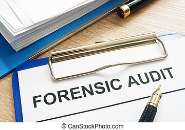 Forensic audit and financial documents on a desk.