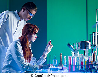 forensic scientists studying a cartridge