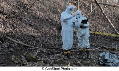 Forensic specialist working in the forest. Police ...