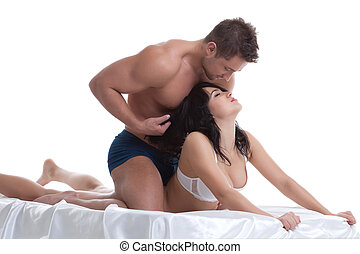 Foreplay of young lovers lying in bed