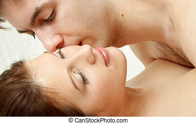 foreplay - couple kissing in bed