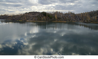 Forest and the Lake in an Abandoned Quarry
