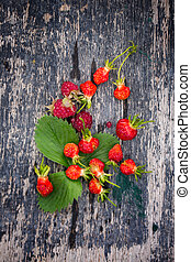 berries on an old wooden table