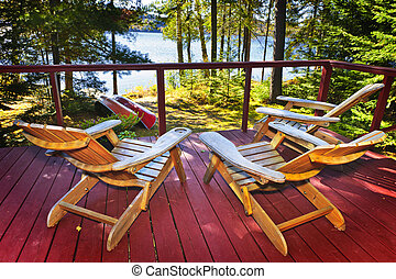 Forest cottage deck and chairs - Wooden deck of cottage with...