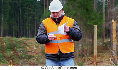 Forest engineer burning sensitive documents in the forest