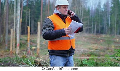 Forest engineer with cell phone