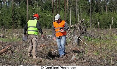 Forest engineers talking in destroy