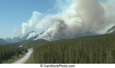 Forest Fire - Flames and smoke of a forest fire in the Rocky...