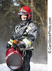 Firefighters extinguish a fire. Firefighter in the forest.