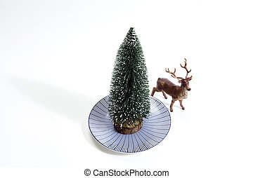 forest firs in a plate and reindeer - Isolated group of full...