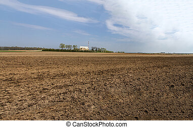 Forest land on the horizon - Lithuania spring plowing fields...