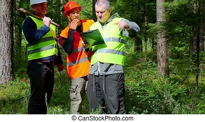 Forest Officer explains to workers their assigned work