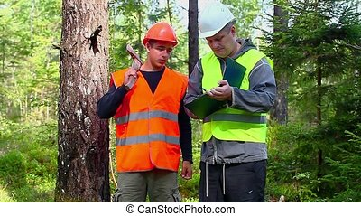 Forest Officer explains to young worker assigned work