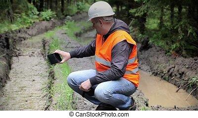 Forest officer filmed with tablet