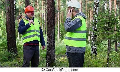 Forest Officer talking on cell phone