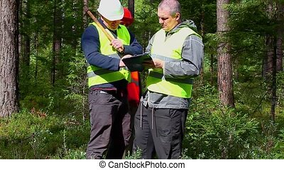 Forest Officer with two workers and documentation