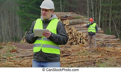 Forest Officer working with tablet